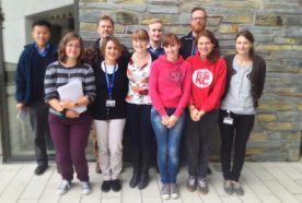 Posed image of microbial systems group outside the ESI