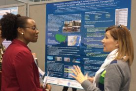 PhD student Julie Hollenbeck presenting her poster