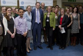 Daniel Poulter MP standing with research staff at the Centre