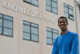 Ghanaian student Gameli Adzaho standing in front of the Knowledge Spa
