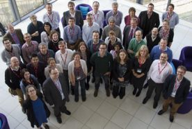 The HPRU group of researchers all pose for a photo, taken from above