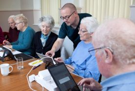 Older people explore smart home technology on portable tablets
