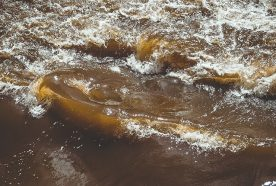 A close up of a brown river flowing